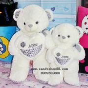 Gấu bông ôm tim chữ Love hoa hồng TNB-23